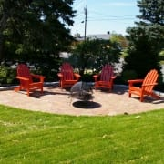 walkway and patio design in portsmouth nh with orange chairs.